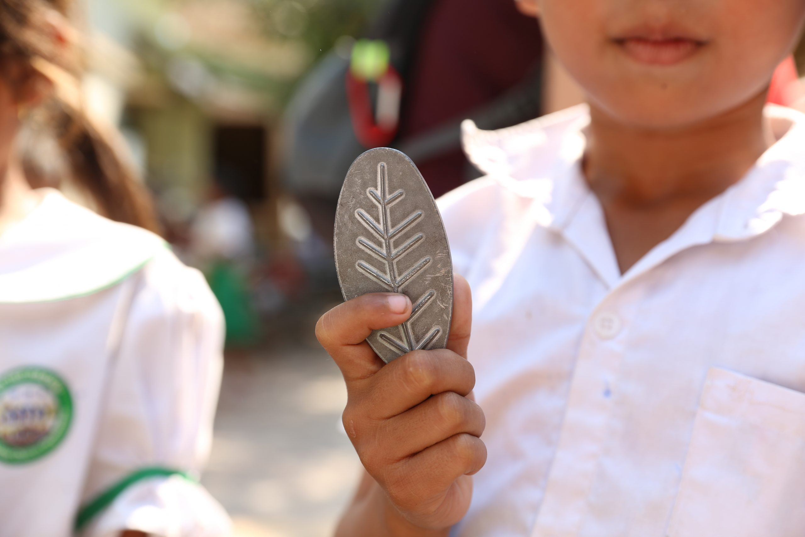 Child holding Lucky Iron Leaf